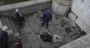 A man lies injured after a shottingt incident on Westminster Bridge in London