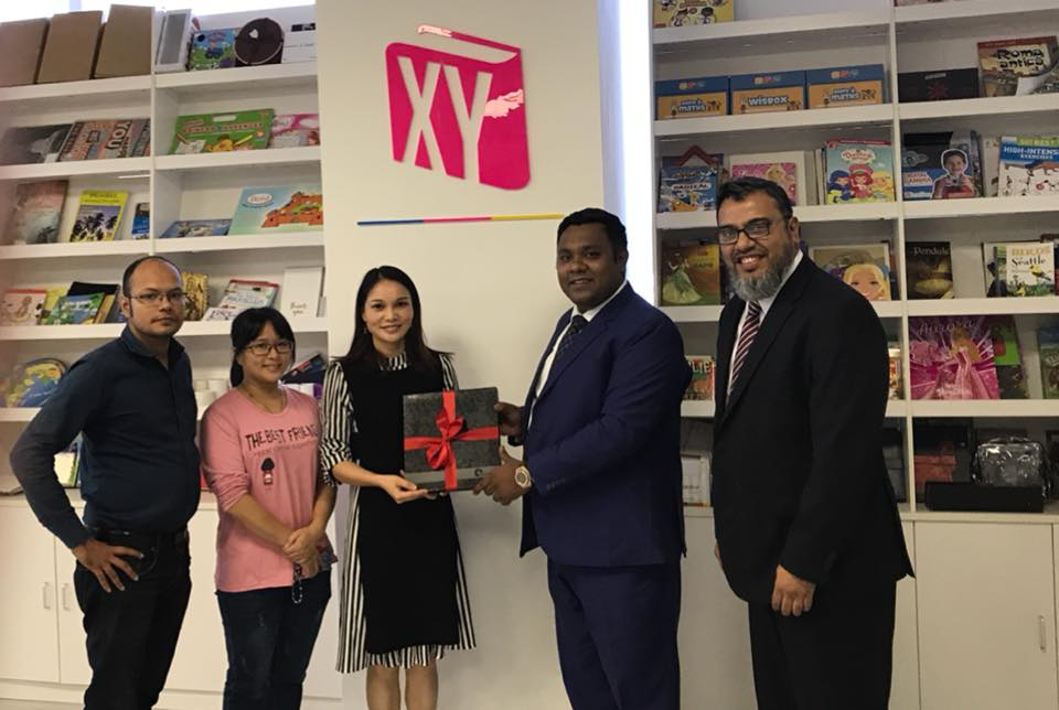 An efficient team of Omicon Publishing House were present in the fair led by Engr Mehedi Hasan, In the picture Engr Mehedi Hasan giving a gift book a foreign woman publisher